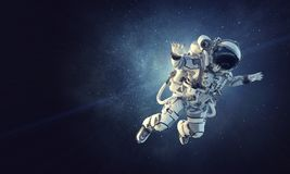 Astronaut on space mission. Mixed media. Astronaut floating in space gravity. Mixed media stock image