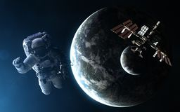 Astronaut, space station, exoplanet with moon in light of blue star. Elements of the image are furnished by NASA. Astronaut, space station, exoplanet with moon stock image