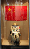Astronaut space suit on a background of Chinese flag in the Inner Mongolia Museum. HOHHOT, INNER MONGOLIA - JUL 12, 2011: Astronaut space suit on a background of Stock Photo
