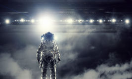 Astronaut in space suit . Mixed media royalty free stock image