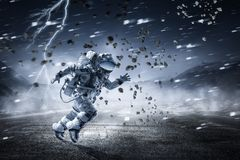 Spaceman running fast. Mixed media stock image