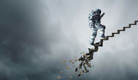 Spaceman running fast. Mixed media. Astronaut in space suit running on stone falling staircase. Mixed media Royalty Free Stock Photo