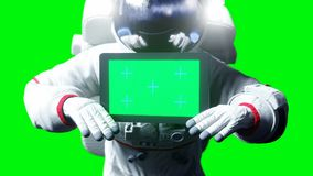 Astronaut in space with tablet, monitor. Green screen tracking footage. 3d rendering. Astronaut in space with tablet, monitor. Green screen tracking footage. 3d Royalty Free Stock Image