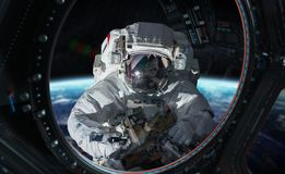 Astronaut working on a space station 3D rendering elements of th. Astronaut in space working on a space station 3D rendering elements of this image furnished by Royalty Free Stock Image