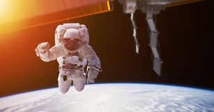 Astronaut working on a space station 3D rendering elements of th. Astronaut in space working on a space station 3D rendering elements of this image furnished by Stock Images