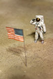 Astronaut or spaceman working on moon. Salute the USA flag Royalty Free Stock Photos