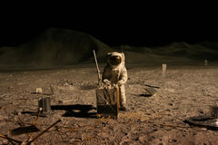 Astronaut or spaceman working on moon. With equipment Royalty Free Stock Image