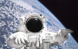 Astronaut in spacesuit close up in outer space. Planet Earth from outer space. stock photos