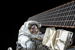 Astronaut on spacewalk Stock Images