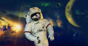 Astronaut Spacewalk Outer Space Galaxy. An astronaut is taking a spacewalk in outer space. Behind him is the cosmos and galaxy with an array of colors. The space Stock Photo