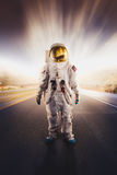 Astronaut standing on a road Royalty Free Stock Photography
