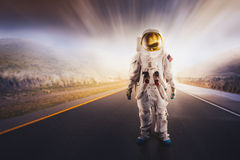 Astronaut standing on a road Stock Images