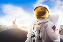 Astronaut standing on a road royalty free stock image