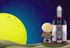 An astronaut standing beside the rocket Stock Image