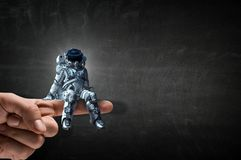 Spaceman on finger. Mixed media royalty free stock photos