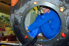 Astronaut Terry Virts in Soyuz Spacecraft During Fit Check. ISS Expedition 42-43 NASA flight engineer Terry Virts in the hatchway of the Russian Soyuz TMA-15M Royalty Free Stock Photography