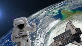 Astronaut with the tool and shuttle above the Earth stock video footage