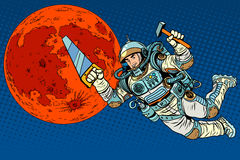 Astronaut with tools for building a colony on Mars. Pop art retro style. Saw and hammer tools Royalty Free Stock Photo