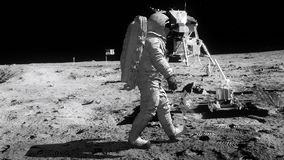 Astronaut walking on the moon.