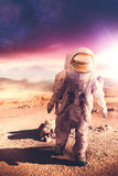 Astronaut walking on an unexplored planet stock photography