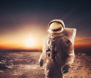 Astronaut walking on an unexplored planet Stock Photos