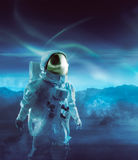 Astronaut walking on an unexplored planet Stock Photo