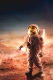 Astronaut walking on an unexplored planet stock photo