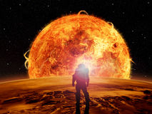 An astronaut watches an alien sun. Rise over a rocky moon. Sci-fi Fantasy artwork Royalty Free Stock Images