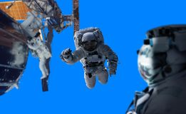 Astronaut working on a space station 3D rendering elements of th. Astronaut in space working on a space station 3D rendering elements of this image furnished by Royalty Free Stock Images
