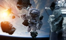 Astronaut working on a space station 3D rendering elements of th. Astronaut in space working on a space station 3D rendering elements of this image furnished by Royalty Free Stock Photo