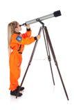 Astronauta: Astrónomo futuro Looking Through Telescope Imagen de archivo libre de regalías