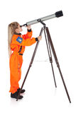 Astronauta: Astronomo futuro Looking Through Telescope Immagine Stock Libera da Diritti