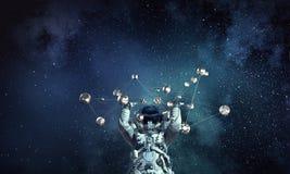 Astronauta e concetto del collegamento Media misti Immagini Stock Libere da Diritti