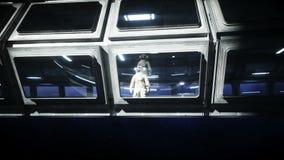 Astronauta sozinho no corredor futurista do espa?o, sala vista da terra metragem 4k cinem?tico ilustração do vetor