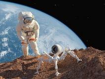 Astronauta y robot Fotos de archivo libres de regalías