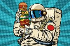 Astronaute avec un hamburger géant illustration de vecteur