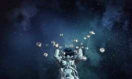 Astronaute et concept de connexion Media mélangé Images libres de droits