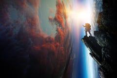 Astronaute et plan?te, humains dans le concept de l'espace photographie stock