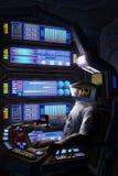 Astronaute mort à l'intérieur d'un vaisseau spatial Photographie stock