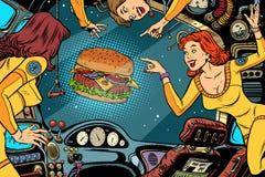 Astronautes de femmes dans la carlingue d'un vaisseau spatial et d'un hamburger illustration de vecteur