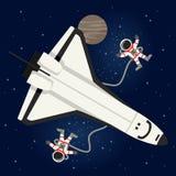 Astronautes et navette dans l'espace extra-atmosphérique Photo stock