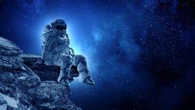 Astronautet vaggar på kanten Blandat massmedia fotografering för bildbyråer