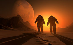 The astronauts. Silhouette of the astronauts on the background of the sunset Stock Image