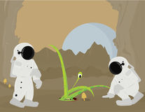 Astronauts and alien on planet surface Stock Image