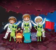 Astronauts and aliens on the same planet Royalty Free Stock Image