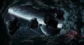 Astronauts exploring a cave in asteroid 3D rendering elements of. Astronauts with spaceship exploring a cave in asteroid in space 3D rendering elements of this Stock Images