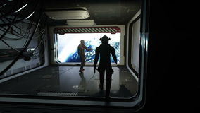 Astronauts in futuristic space corridor, room. view of the earth. Cinematic 4k footage.