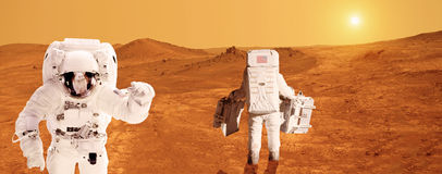 Astronauts on Mars - Elements of this image furnished by NASA. Two astronaut on the surface of planet Mars Stock Image