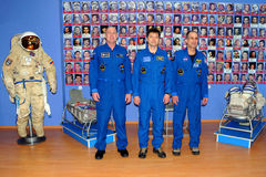 Astronauts at the Museum. Increment 31 crew (L-R: Andre Kuipers, Oleg Kononenko, Don Pettit) pose for pictures at the Korolev Museum on the 16th of December Royalty Free Stock Image