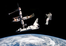 Astronauts in outer space - Elements of this image furnished by NASA Royalty Free Stock Images